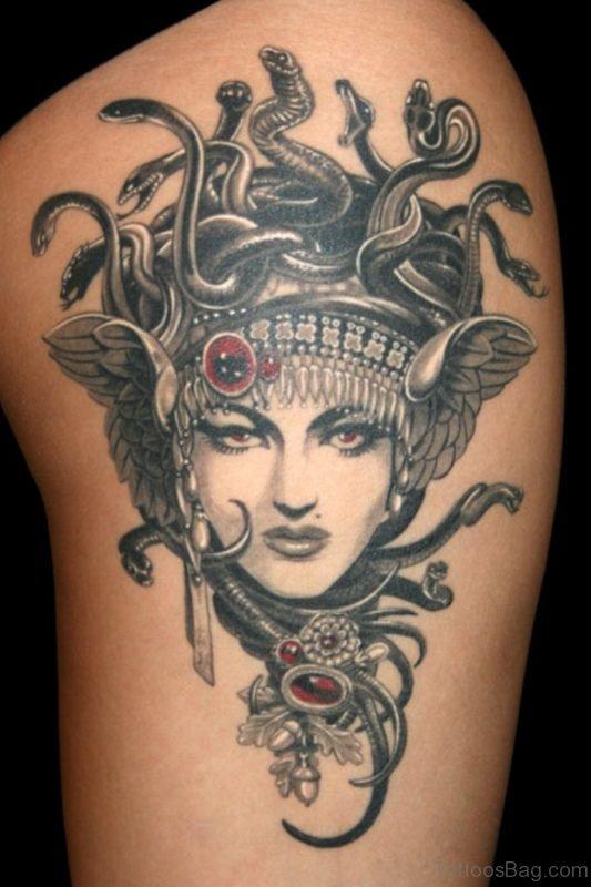 Black And White Medusa Head Tattoo On Thigh
