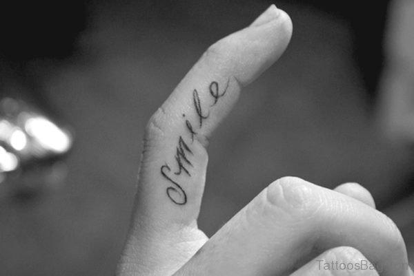 Black And White Smile Tattoo On Finger