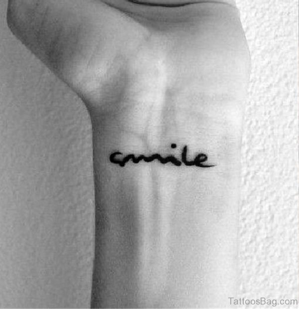 Black And White Smile Wrist Tattoo