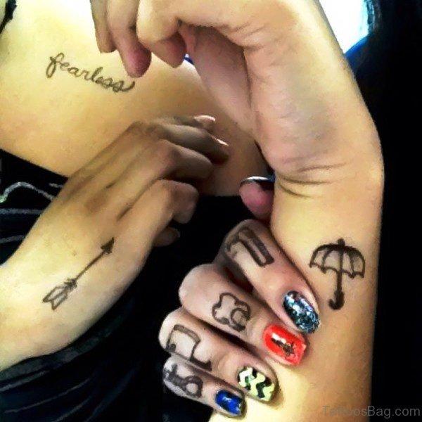 Black Arrow Tattoo Design On Girls