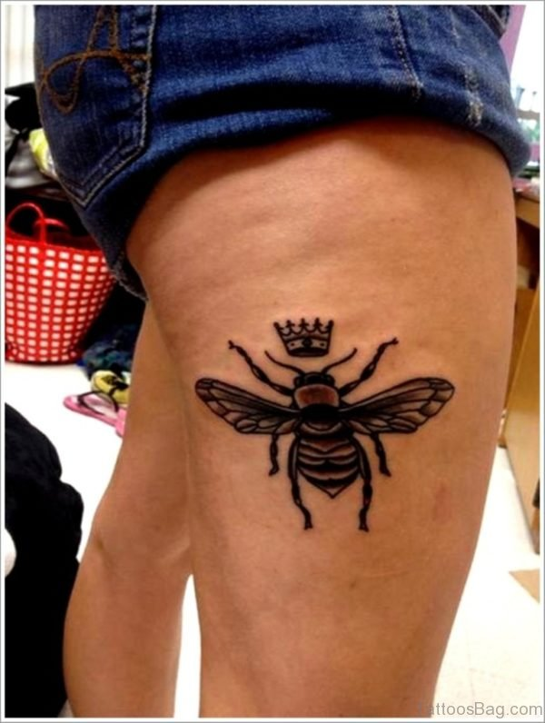 Black Bee With Crown Tattoo On Side Thigh