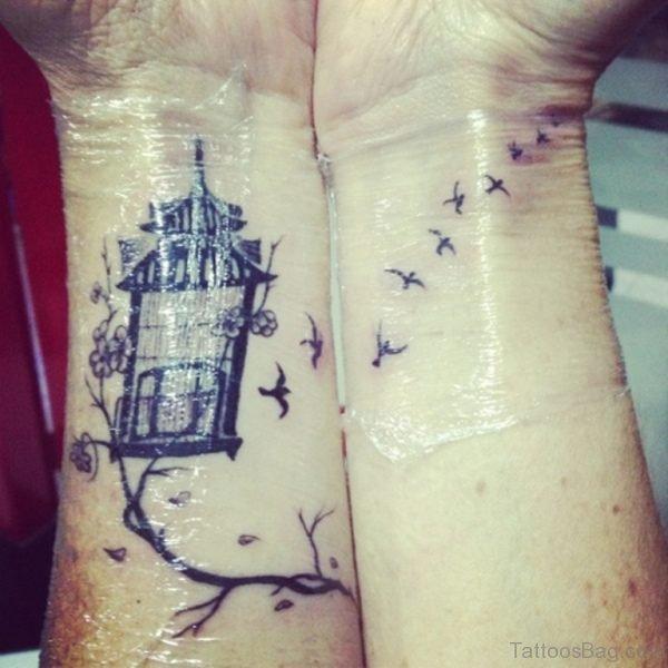 Black Bird And Cage Wrist Tattoo