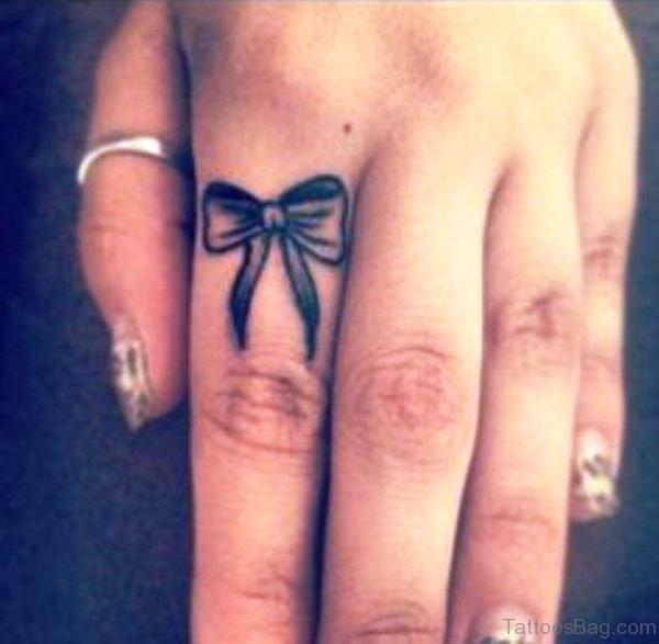 Black Bow Tattoo On Finger
