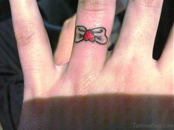 Black Bow Tattoo On Ring Finger