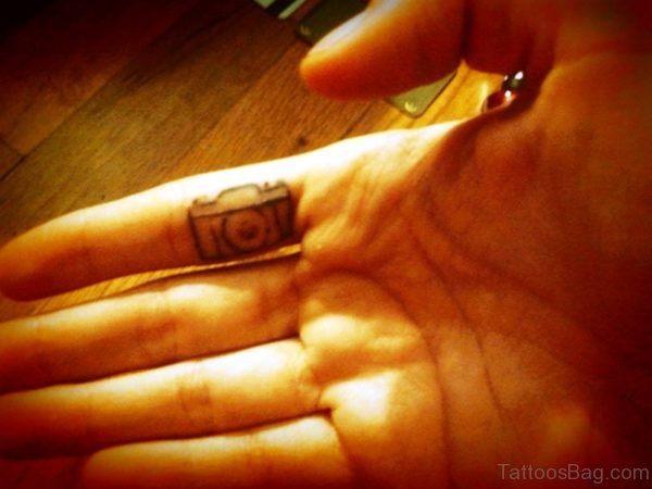 Black Camera Tattoo On Inner Finger