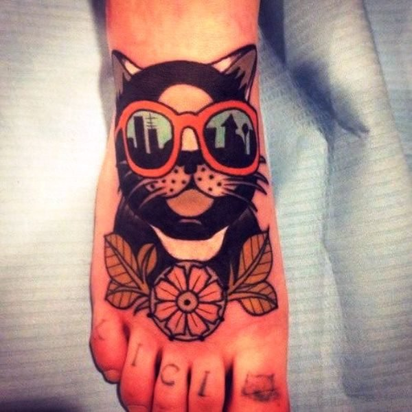 Black Cat With Flower Tattoo On Foot