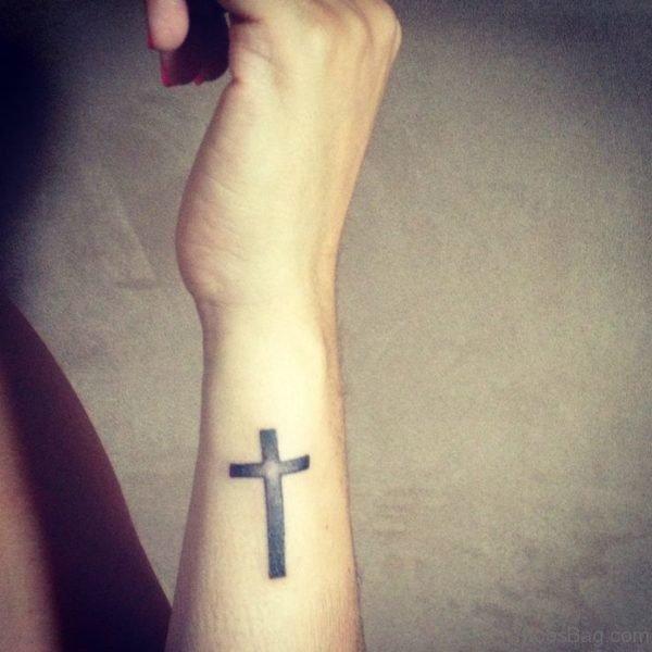 Black Cross Tattoo On Side Wrist