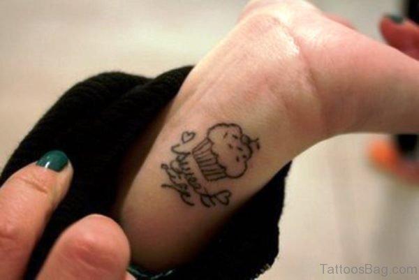 Black Cupcake Tattoo On Wrist