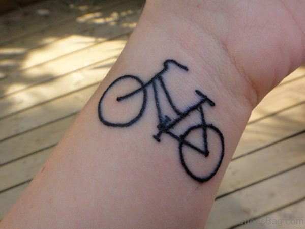 Black Cycle Tattoo On Wrist