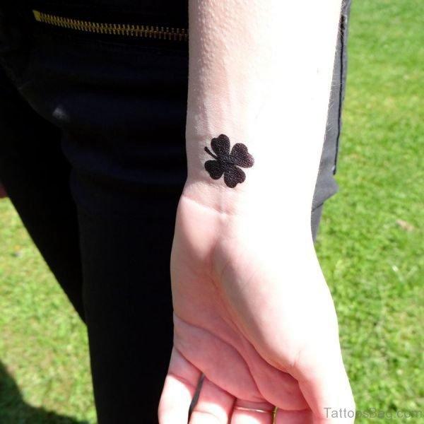Black Four Leaf Tattoo On Wrist