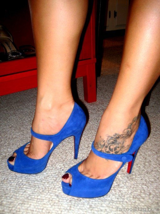 Black Graphes Tattoo Design On Ankle