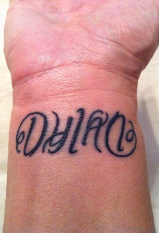 Black Ink Ambigram Tattoo On Right Wrist
