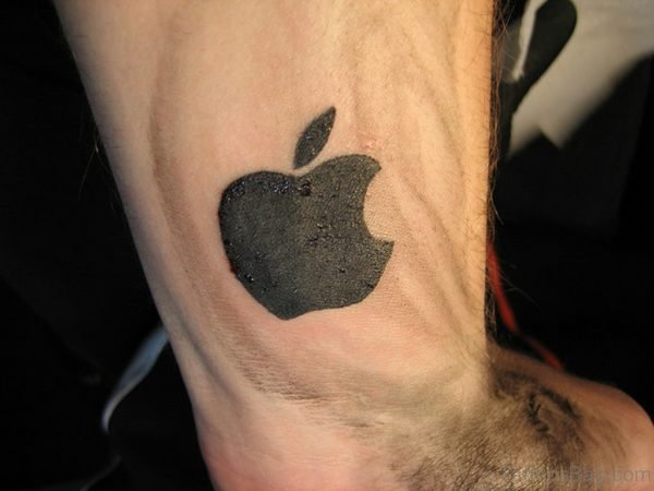 Black Ink Apple Logo Tattoo On Wrist