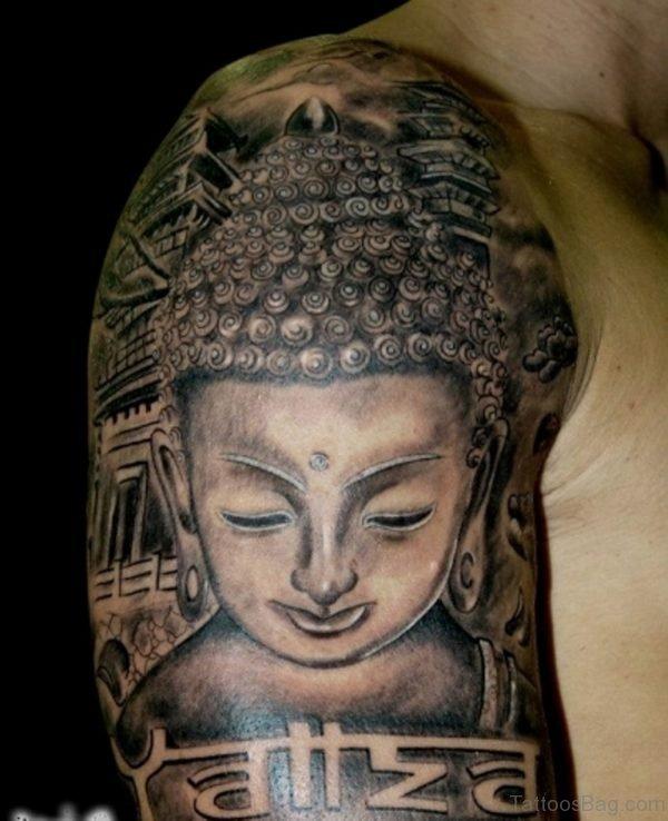 Black Ink Buddha Tattoo On Shoulder