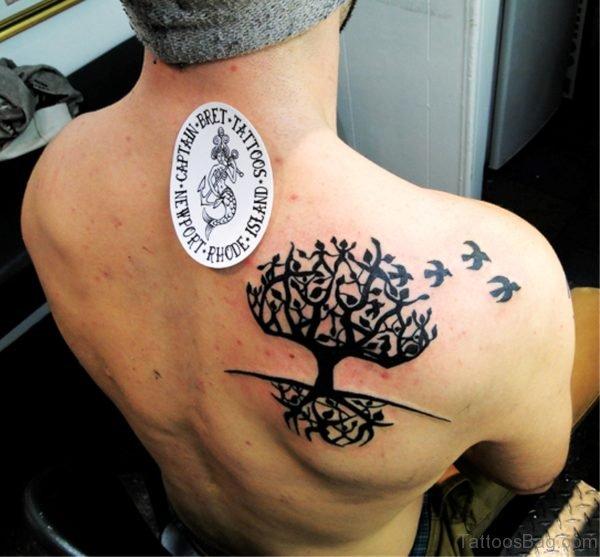 Black Ink Celtic Tree Tattoo