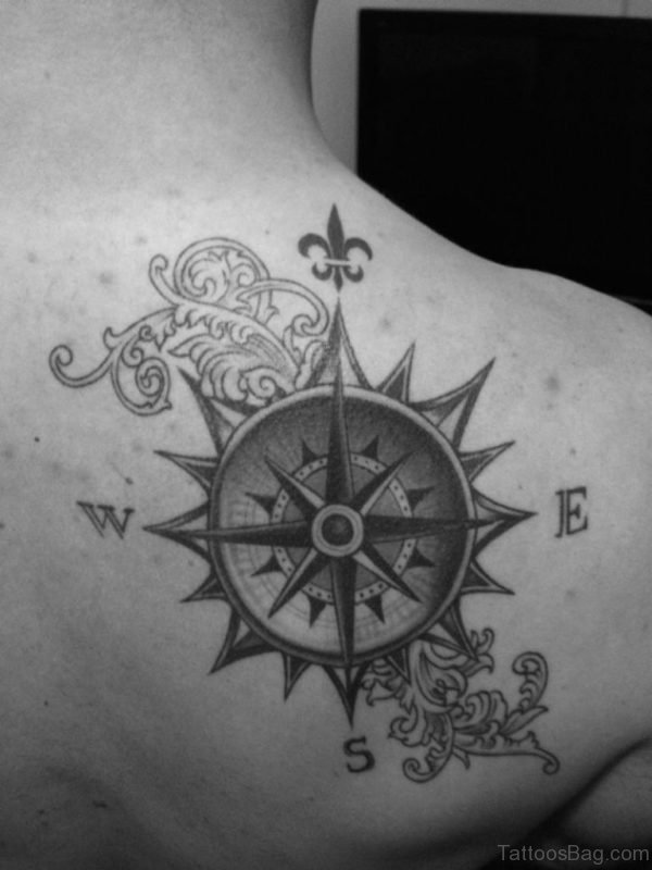 Black Ink Compass Tattoo On Back