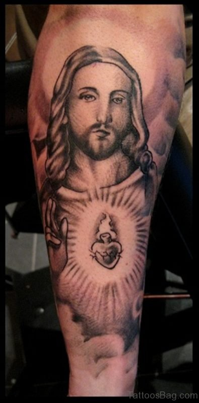 Black Ink Heart With Jesus Tattoo On Arm