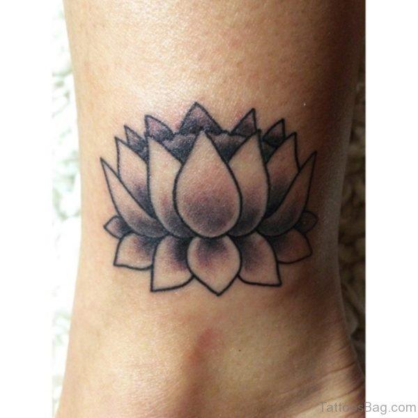 Black Ink Lotus Flower Tattoo Design For Inner Ankle