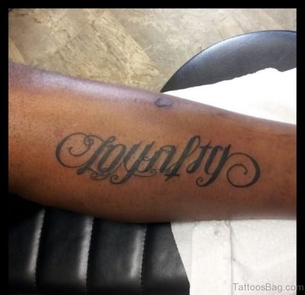 Black Ink Loyalty Ambigram Tattoo On Arm