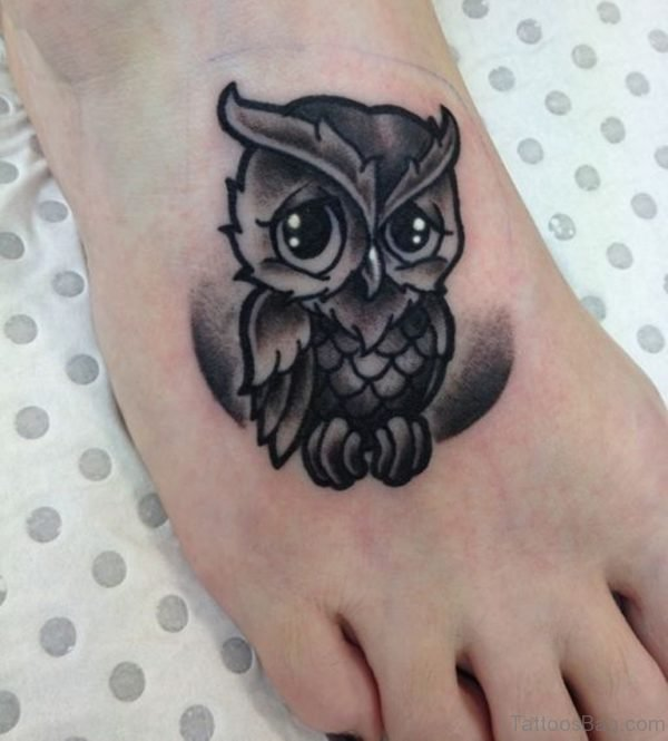 Black Ink Owl Tattoo On Foot