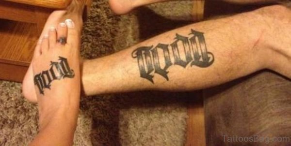 Black Ink Todd Ambigram Tattoo On Leg And Foot