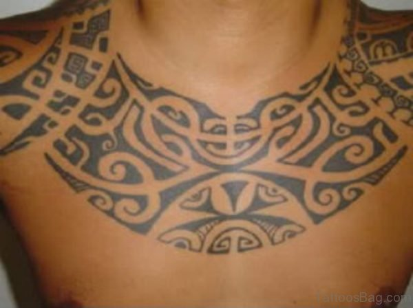 Black Ink Tribal Hawaiian Tattoo On Man Chest