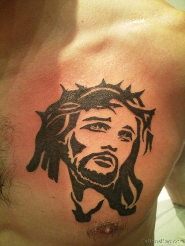 Black Ink Tribal Jesus Head Tattoo On Chest