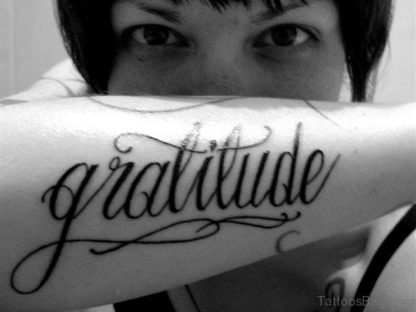 Black Ink Wording Tattoo On Arm