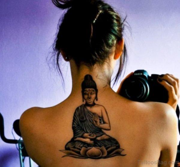 Black Inked Buddha Tattoo On Back