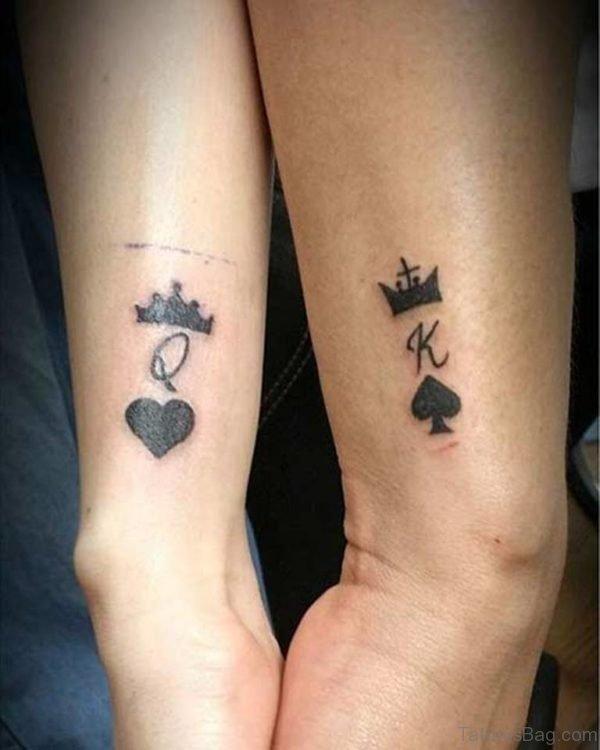 Black K And Q Tattoo On Wrist