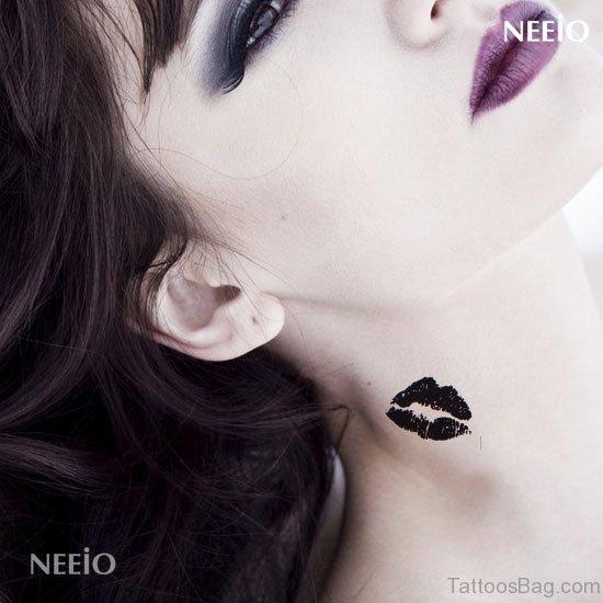 Black Kiss Tattoo On Neck