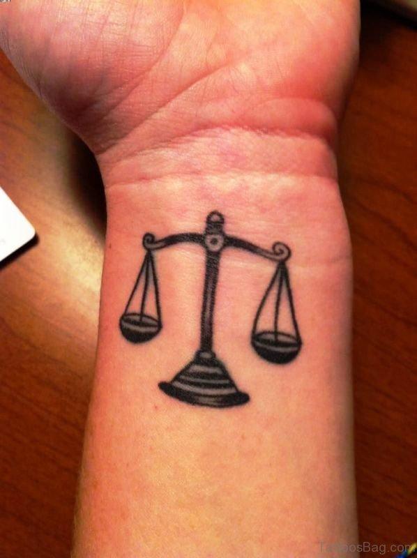 Black Libra Wrist Tattoo