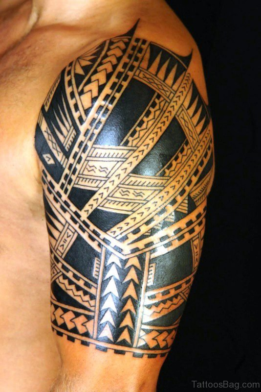 Black Maori Tattoo Design On Left Shoulder
