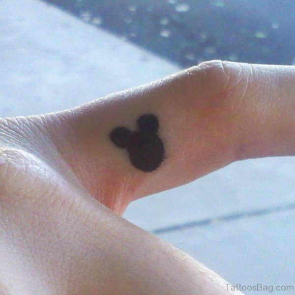Black Mickey Mouse Tattoo On Finger