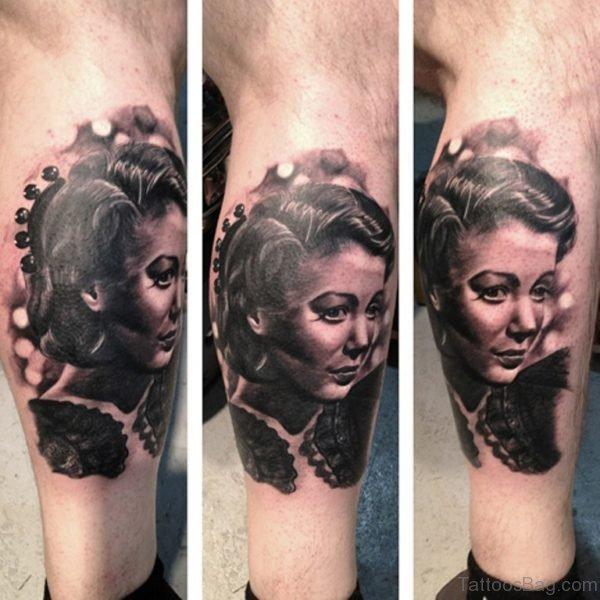 Black Portrait Tattoo On Leg