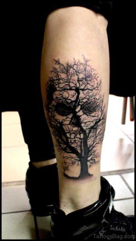 Black Scary Tree With Skull Tattoo