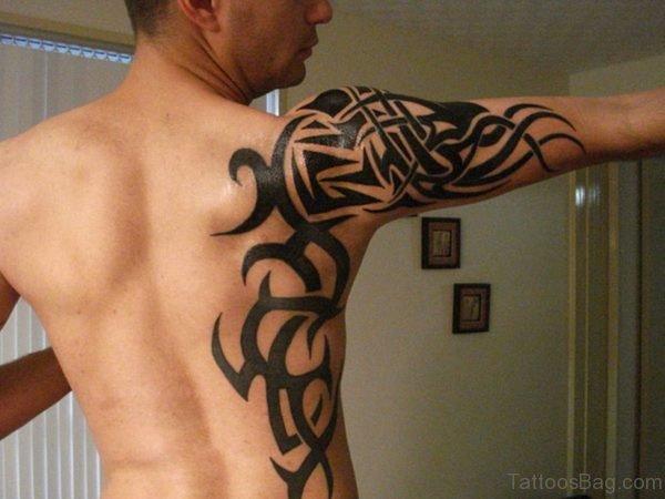 Black Tribal Tattoo On Right Shoulder Back