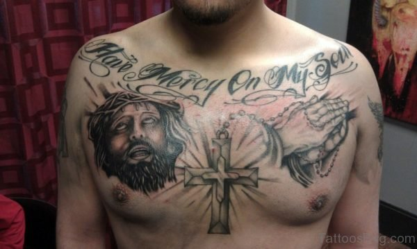 Black Wording And Jesus Tattoo On Chest
