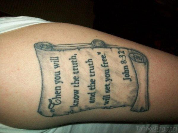Black Wording Tattoo On Thigh