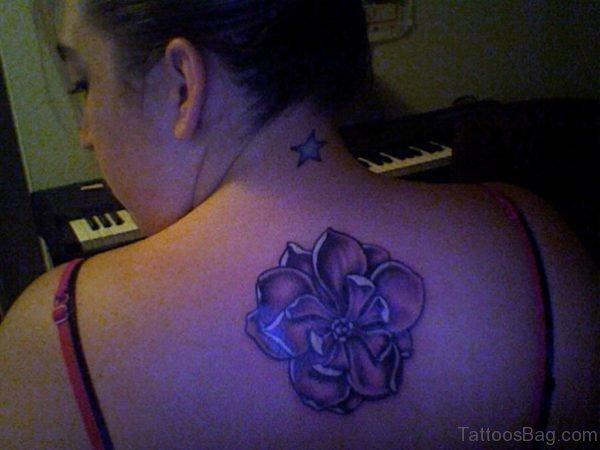 Blacklight Magnolia Tattoo On Upper Back