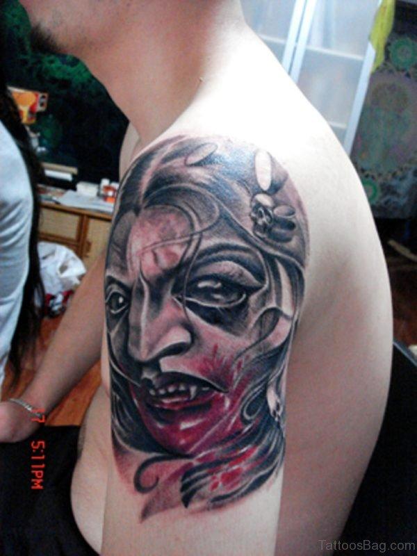 Bleeding Girl Mask Tattoo For Shoulder