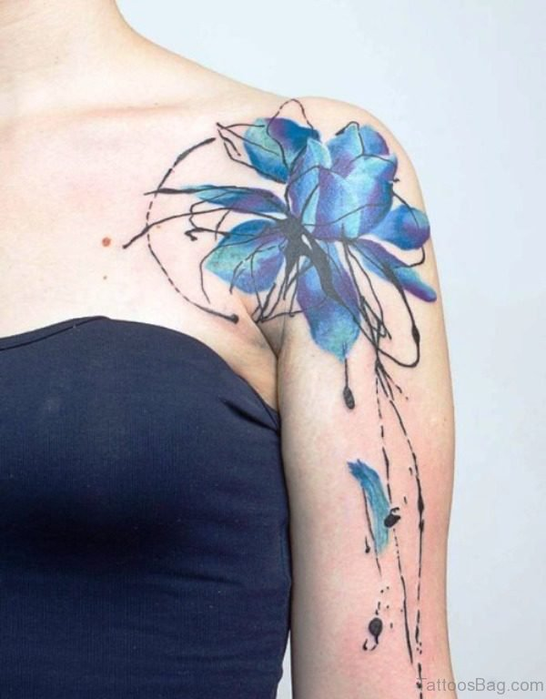 Blue Colored Tattoo On Front Shoulder