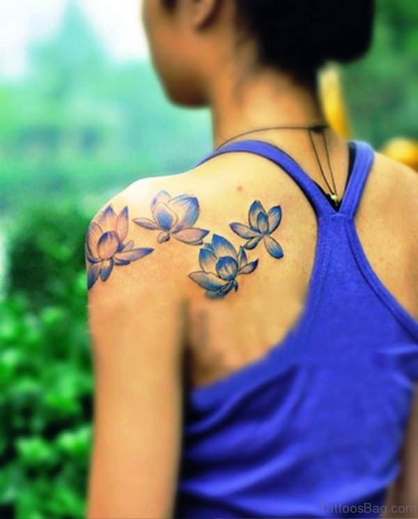 Blue Flower Tattoo On Back Shoulder