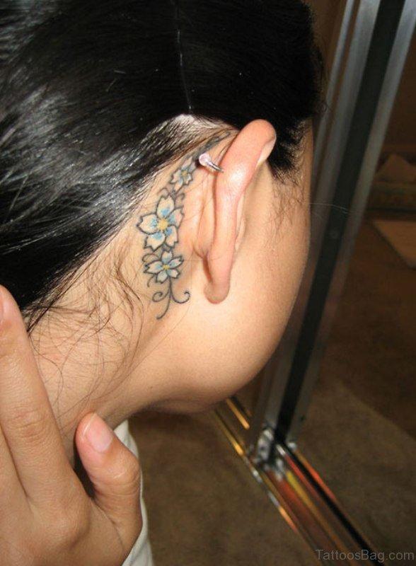 Blue Flowers Tattoo Behind Ear
