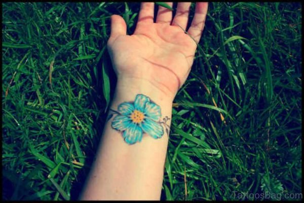 Blue Hibiscus Wrist Tattoo