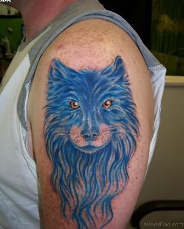 Blue Ink Wolf Tattoo On Shoulder