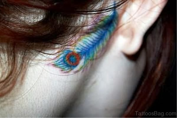 Blue Peacock Feather Tattoo On Neck