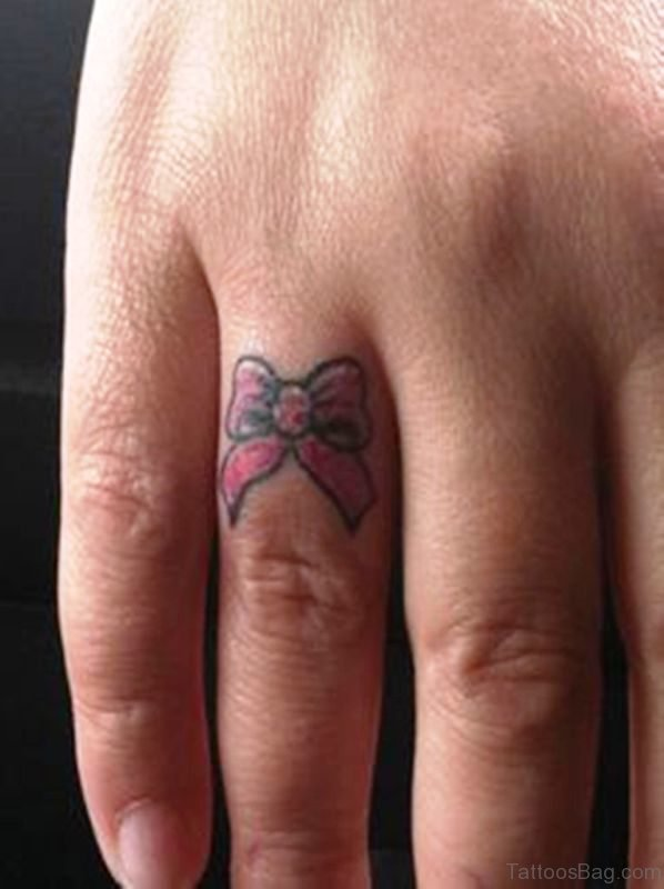 Bow Tattoo On Ring Finger