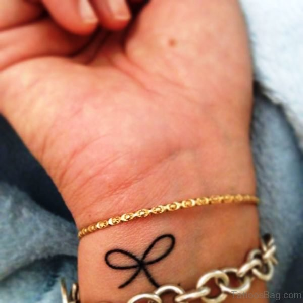 Brilliant Black Bow Tattoo On Wrist
