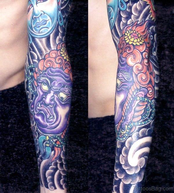 Buddha And Evil Tattoo On Sleeve